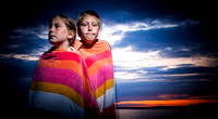 Two Kids in Towels at Sunset